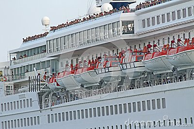 Passengers while greeting from cruise ship sets sail from the po