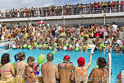 Passengers lined up on edge of pool Editorial Photography