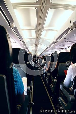Free Passengers Onboard Plane Stock Photo - 1124550