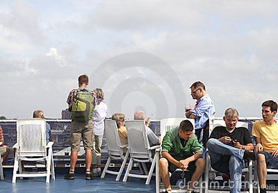 Passengers on the sundeck of the ferry Editorial Stock Photo