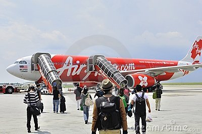 Passengers walking to Air Asia 330 Editorial Photography