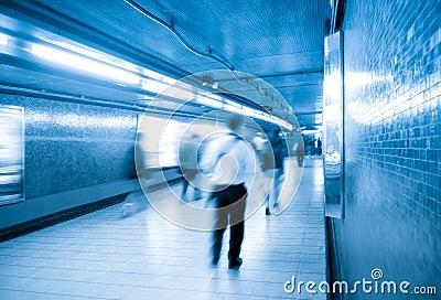 Passengers walking in underpass