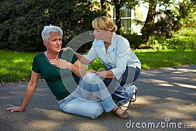 Passerby helping senior woman