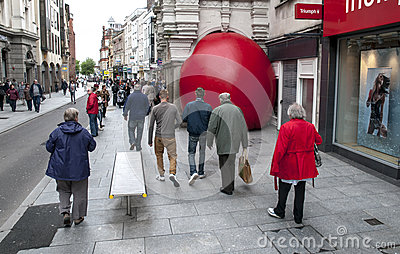 Passersby look at Kurt Perschke s giant Red Ball Editorial Image