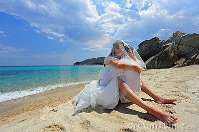 Passionate embrace on a tropical beach