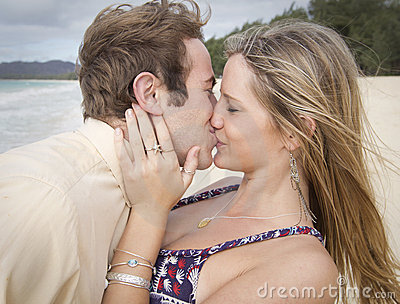 Passionate kiss on the beach