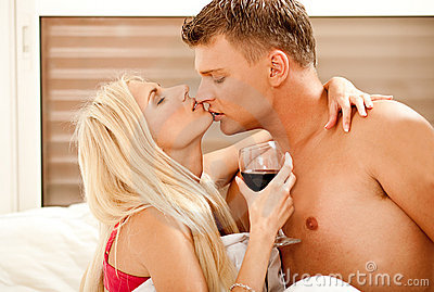 Passionate married couple enjoying in bed
