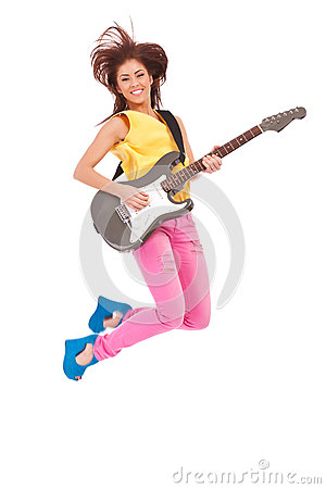 Passionate woman guitarist jumps in the air