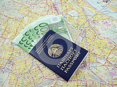 Passport with money over map