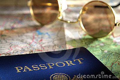 Passport and Sunglasses over Road Travel Map