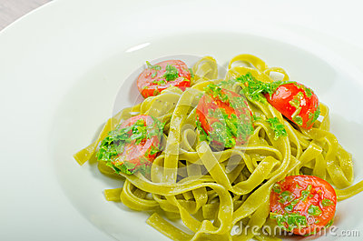 Pasta With Basil Pesto And Pine Nuts, Cherry Tomatoes Stock Photo ...