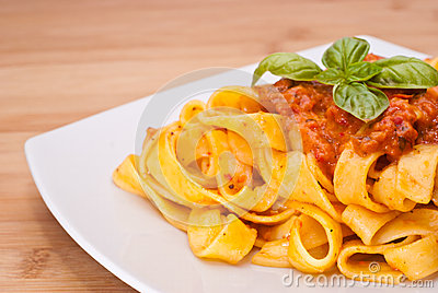 Pasta decorated with basil leaves