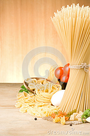 Pasta and food ingredient on wood
