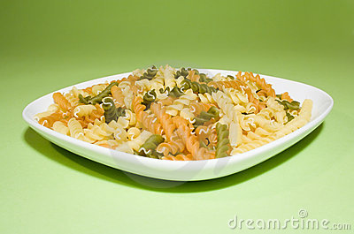 Pasta on green background