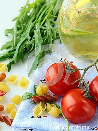 Pasta ingredient olive oil, basil, tomato