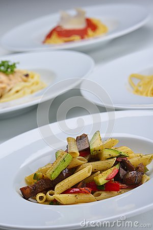 Pasta with shrimps, herbs and mashrooms Stock Photo