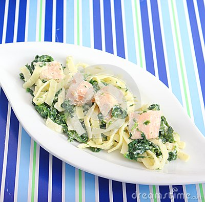 Pasta with spinach and salmon fish