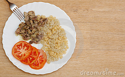 Pasta stew slices meat tomato plate