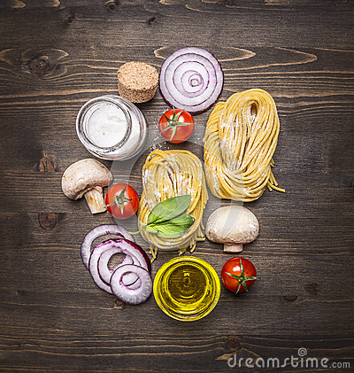 Free Pasta With Fresh Vegetables , Preparation With Flour On Rustic Wooden Background, Top View. Vegetarian Food Healthily Cooking Stock Image - 63780911