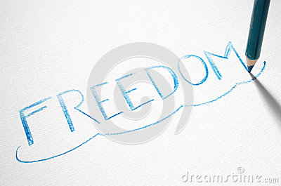 Pastel pencil writing the word Freedom