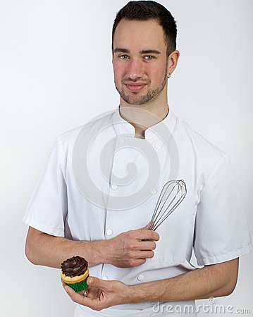 Pastry chef with whisk and cupcake