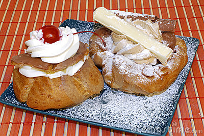 Pastry with fruit and whipped cream.