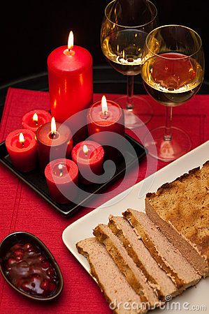 Pate easter dish with wine glasses