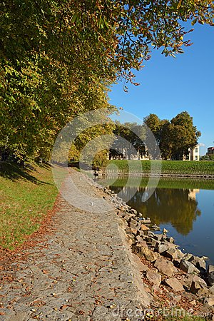 Path in autumn near water in Nymburk city