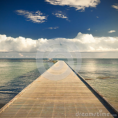 Free Path On The Pier By The Ocean With Blue Sky And Clouds Royalty Free Stock Photos - 49075378