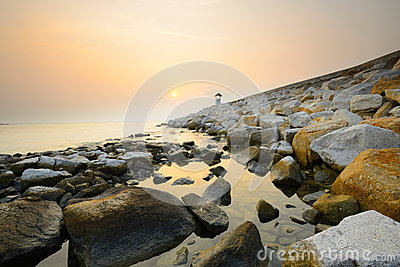 Path on the rock beach at sunrise