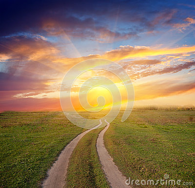 Path in steppe to sunset