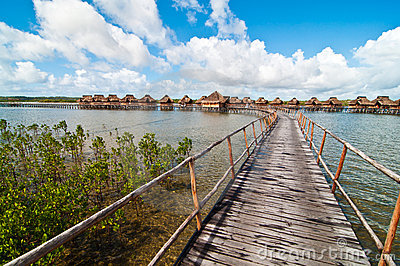 Walkway to bungalows in a lagoon