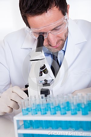 Pathologist or lab technician using a microscope