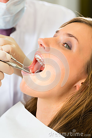 Patient with Dentist - dental treatment