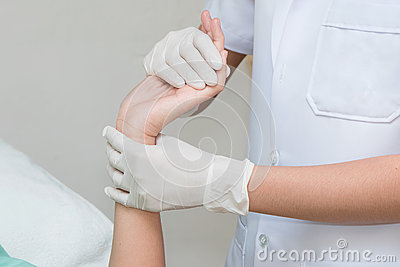 Patient doing physical exercises with physical therapist Stock Photo