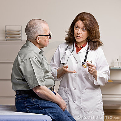 Patient listening to doctor explain prescription