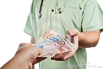 Patient paying to the doctor.