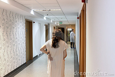 Patient walking in hospital hallway