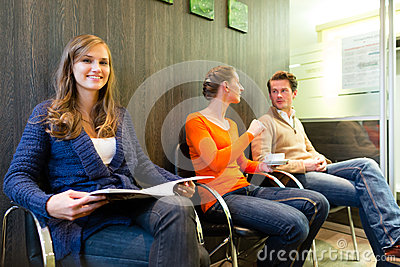 Patients in the waiting room of a doctors office