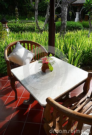 Patio furniture of a balinese garden