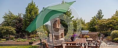 Patio outdoor kitchen and garden with green umbrella