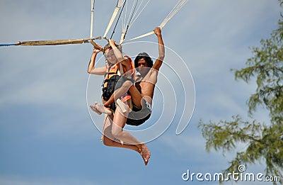 Patong, Thailand: Couple Parasailing Editorial Photography