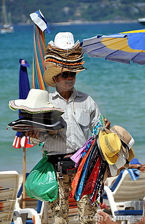 Patong, Thailand: Man Selling Hats on Beach Editorial Stock Image