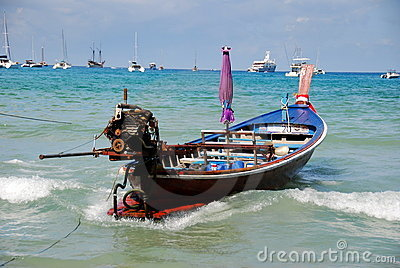 Patong, Thailand: Thai Longboat in Ocean Editorial Stock Photo