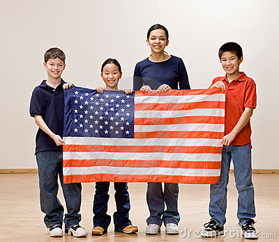 Patriotic children holding up the American flag