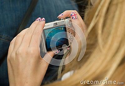 Patriotic Olympics fan checks her photos Editorial Stock Photo