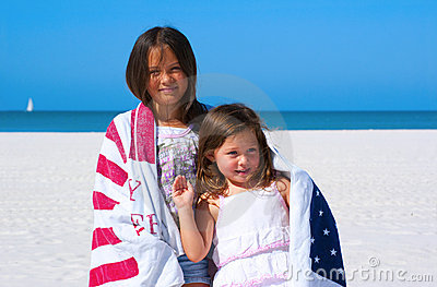 Patriotic sisters wrapped in American flag towel