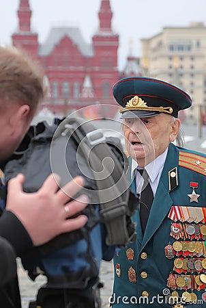 Patriotic War veteran being interviewed Editorial Image