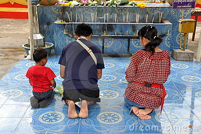 Pattaya, Thailand: Family at Prayer Editorial Stock Image