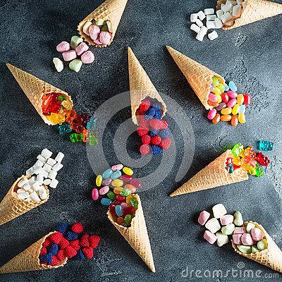 Free Pattern Of Colorful Bright Assorted Candy In Waffle Cones On Dark Background. Flat Lay, Top View Stock Image - 99008881